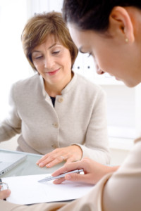 Senior businesswoman and assistant working together in office.
